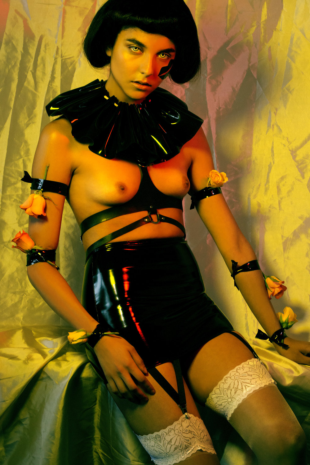 Harness: Broke Boutique; Collar: Tamsin Malones Layzell; Latex skirt: 7Heaven; Stockings: Stylist's own