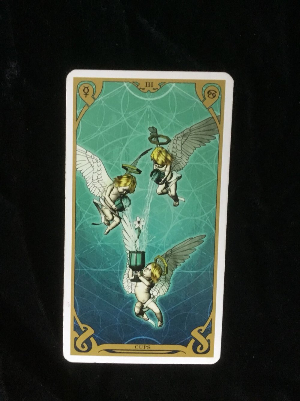 The Three of Cups - This card can represent community - the network of support created when we interact with others.