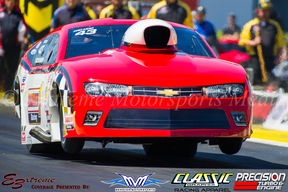 Rickie Smith goes wheels up during Q1 of Pro Mod at the Gator Nationals.