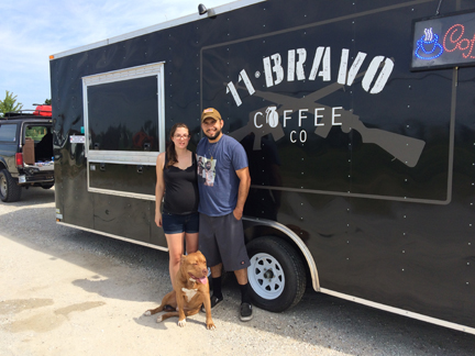 Vic, Erin and their rescue dog, Simba outside the 11 Bravo coffee truck.