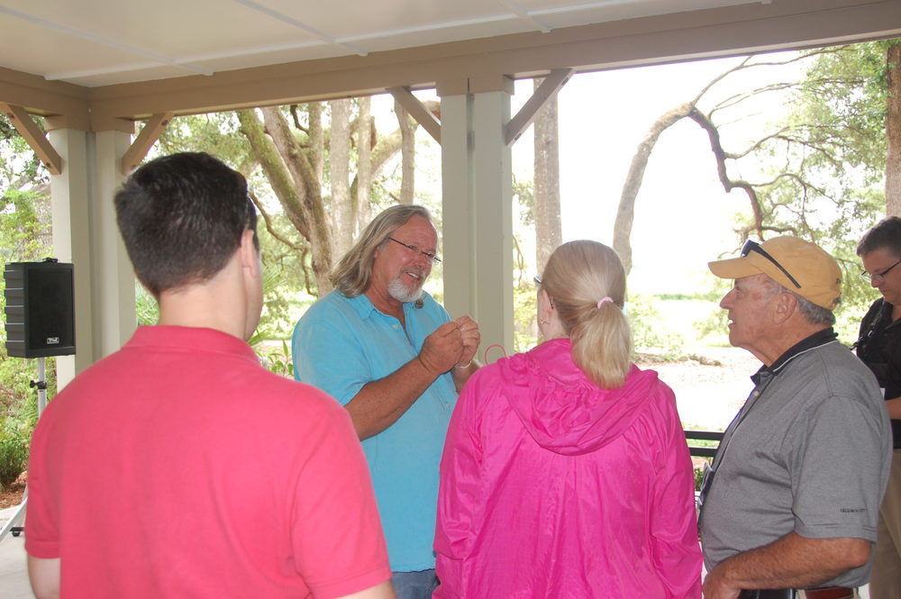 Bill Hall talking with guests