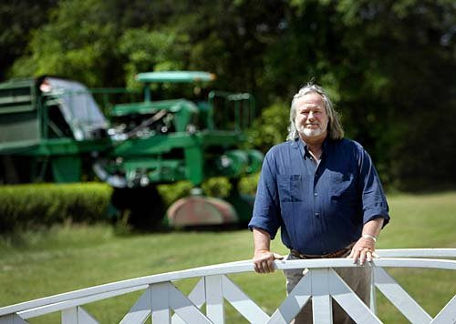 Bill Hall standing in front of the tea harvester