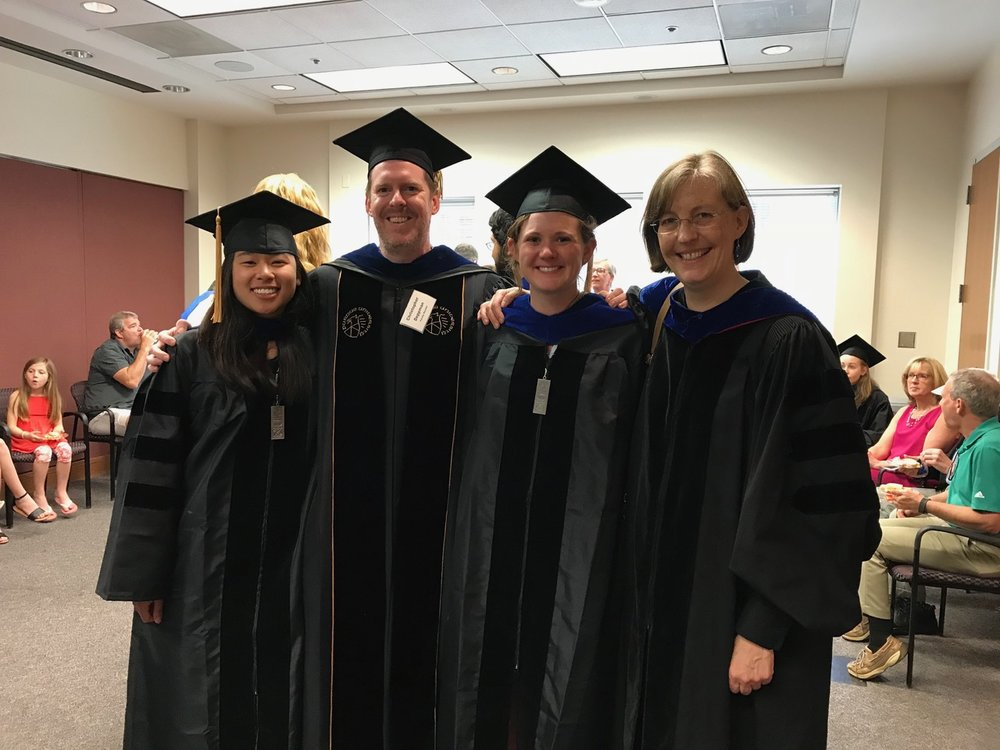 Irene Cheng (far left) and Kelly Barford (third from left) graduate from UVA Neuroscience