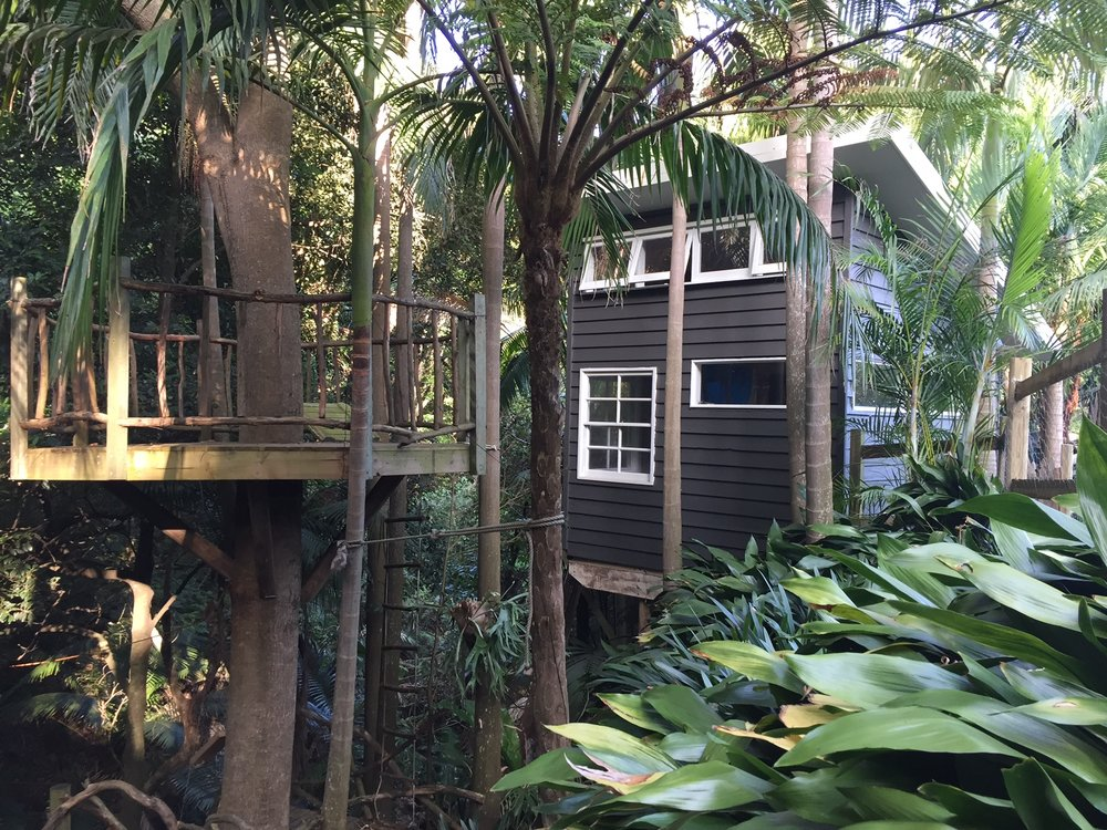 Cubby house guest room built around a tree