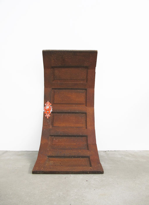 Shaun Flynn,  A Curved Door Opens Around Me , 2009, reconfigured door, traffic cone, resin, 58 x 28 x 30 in