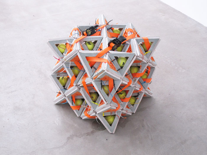 Shaun Flynn,  The Vacuum (64 Tetrahedron) , 2012, drywall, tennis balls, rubber bands, cable ties, fireproof expanding foam, ratchet straps, 19 x 19 x 19 in