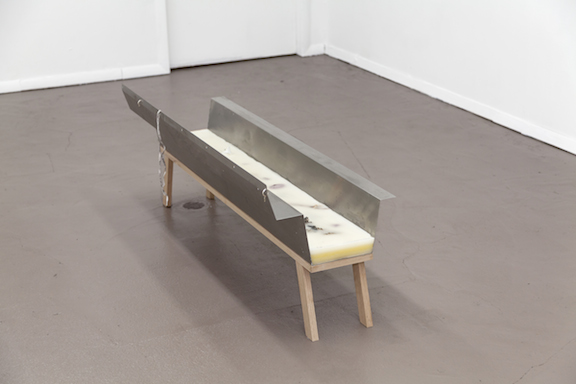 Miami-Dutch,  Trough , 2015, stainless steel, beeswax, paraffin wax, oak, flowers, fish bone, paper, earrings, shoelace, 18.75 x 48 x 15 in