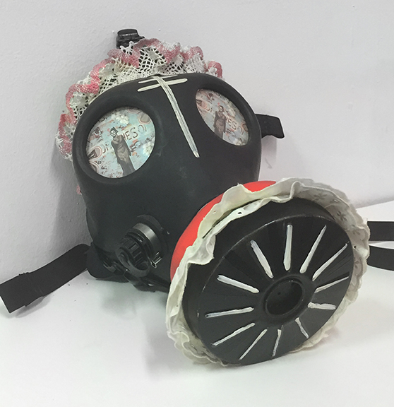 Tamara Gonzales,  Gas Mask , 2006, gas mask with paint and fabric, approximately 21 x 16 x 6 in