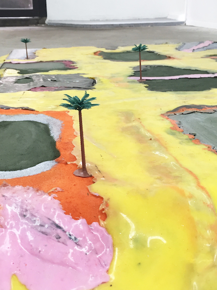 Sara Gernsbacher,  Grass, now dry (detail) , 2015, pigmented silicone, vinyl paint, acrylic paint, spray paint, glitter on drop cloth, wood, model palm trees, 74 x 47 x 8 in