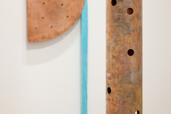Jory Rabinovitz,  EBB  (detail), 2014,  melted pennies, pennies, Verdigris, bricks, rain water,  dimensions variable