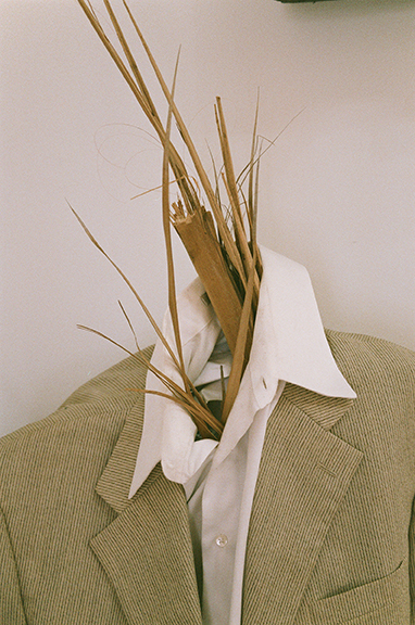 Brian Khek,  Straw Man (Los Angeles) , 2015, two-piece suit, oxford shirt, dried palm leaves, sweet potatoes, and shallots, dimensions variable Installation image by Jesse Stecklow
