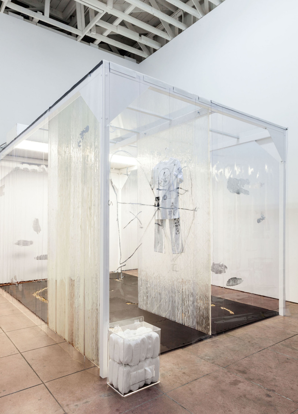 Natalie Labriola,  Cleanroom for Psychic Protection , 2015 - 2016, modified, used ISO-Level 8 cleanroom: heat-pressed powder coated steel beams, fluorescent lights, vents, plexiglas drop ceiling, heat pressed vinyl curtains, anti-microbial interlocking foam mats with juniper berries and crystals cast in wax, silicone caulk on acrylic panels, Velcro, shoe covers, acrylic shoe cover dispenser, 89 x 96 x 144 in