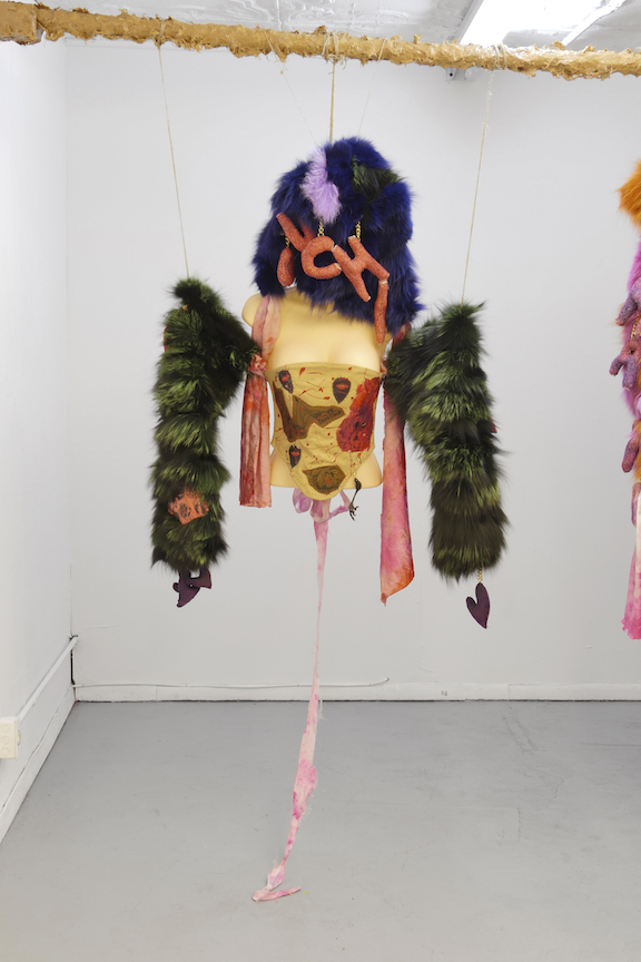 Monster Coat Club & Athena Papadopoulos,  The Bedbug Bustier , 2016, Dyed fox, Mongolian, rabbit, wolf and leather, tattoo ink on leather, image transfers, nail polish, hair dye, wool, wadding, jewellery chain, thread, silk, eyelets, dimensions variable
