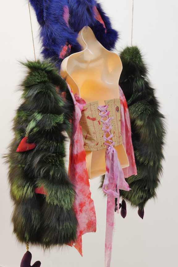 Monster Coat Club & Athena Papadopoulos,  The Bedbug Bustier  (detail), 2016, dyed fox, Mongolian, rabbit, wolf and leather, tattoo ink on leather, image transfers, nail polish, hair dye, wool, wadding, jewelry chain, thread, silk, eyelets, dimensions variable