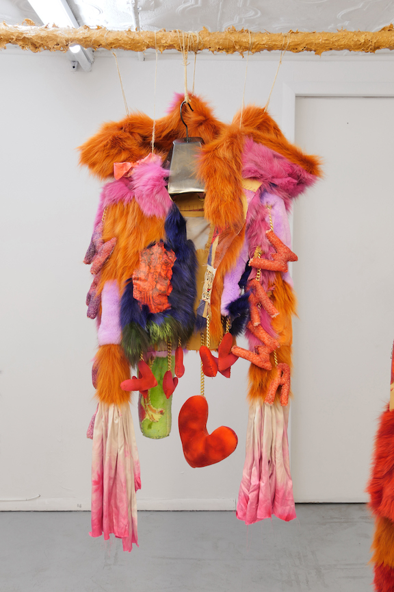 Monster Coat Club & Athena Papadopoulos,  The Amorous Alcoholic , 2016, dyed fox, Mongolian, rabbit, wolf and leather, tattoo ink on leather, image transfers, nail polish, hair dye, wool, wadding, jewellery chain, thread, silk, resin, blades, button, eyelets, dimensions variable