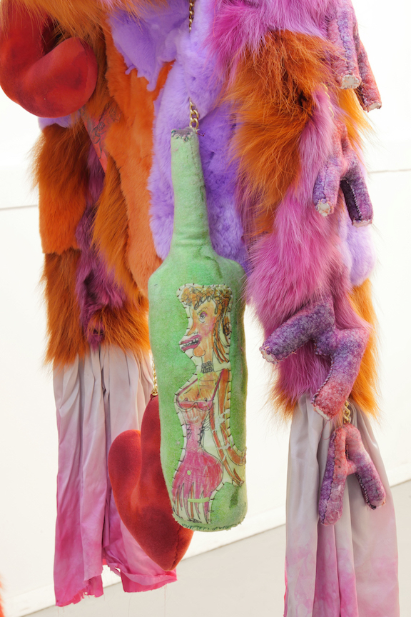 Monster Coat Club & Athena Papadopoulos,  The Amorous Alcoholic  (detail), 2016, Dyed fox, Mongolian, rabbit, wolf and leather, tattoo ink on leather, image transfers, nail polish, hair dye, wool, wadding, jewellery chain, thread, silk, resin, blades, button, eyelets, dimensions variable