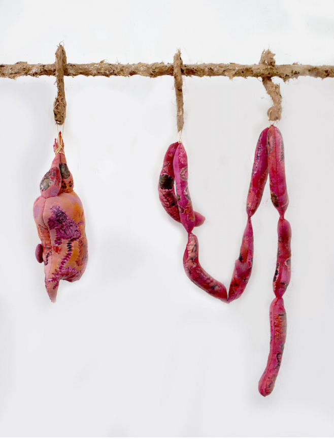 Athena Papadopoulos,  Awful Offal And Foul Fowl, Pricked, Pimped And Plumped (Racks IV & V)  (detail), 2016, hair dye, nail polish, lipstick, Pepto Bismol, red wine on padding/wadding, image transfer on fabric, jewelry chains, stuffing, pine wood dowels, butcher hooks covered in resin-based glue Mixed with Self Tanner and Synthetic Hair clippings, alligator claws coated in resin and nail polish, leather, various objects encapsulated in pigmented polyester resin, waste pipe, wood and screws, dimensions variable