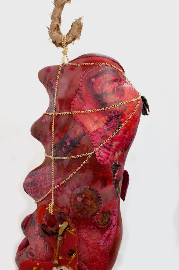 Athena Papadopoulos,  Them Suckling Skirts (Rack II)  (detail), 2016, Hair Dye, Nail Polish, Lipstick, Pepto Bismol, Red Wine on Padding/Wadding, Image Transfer on Fabric, Jewelry Chain, Stuffing, Pine Wood Dowels, Butcher Hooks Covered in Resin-Based Glue Mixed with Self Tanner and Synthetic Hair Clippings, Alligator Claws Coated in Resin and Nail Polish, Leather, Various Objects Encapsulated in Pigmented Polyester Resin, Waste Pipe, Wood and Screws, dimensions variable