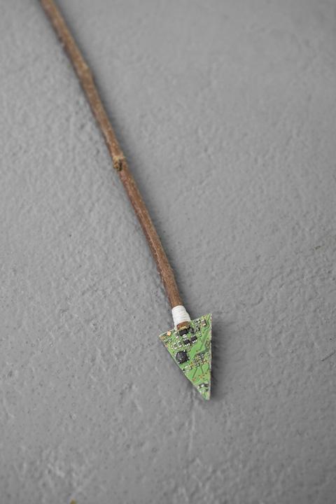 Bea Fremderman, Weapon No. 2 (arrow),  2017,Motherboard, dental floss, branch,19 x 1 in