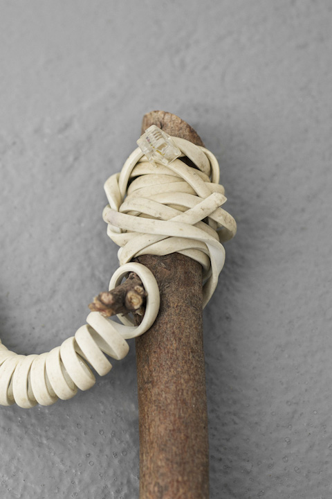 Bea Fremderman,  Weapon No. 3 (telephone cord) (detail) , 2017, Telephone cord, rubber bands, nails, branch, 4 x 32 x 13 in