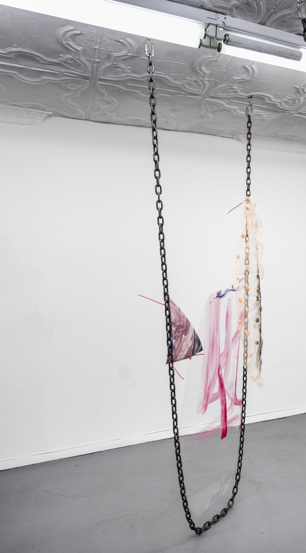 Raque Ford,  4yrs,  Acrylic paint on polypropelene, steel chain, zip ties and fabric, 86 x 32 in