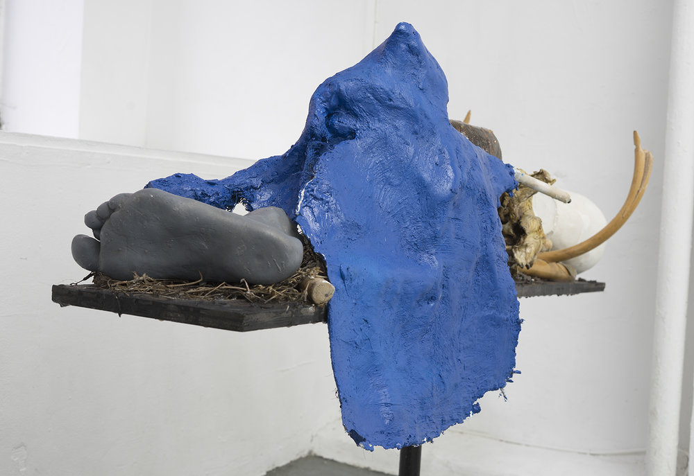 Brandon C Ndife,    Globetrotter , 2018, Cast resin, Winter Oyster mushroom, organic plant matter, wood, hydrocal, steel, 32 × 48 × 16 in