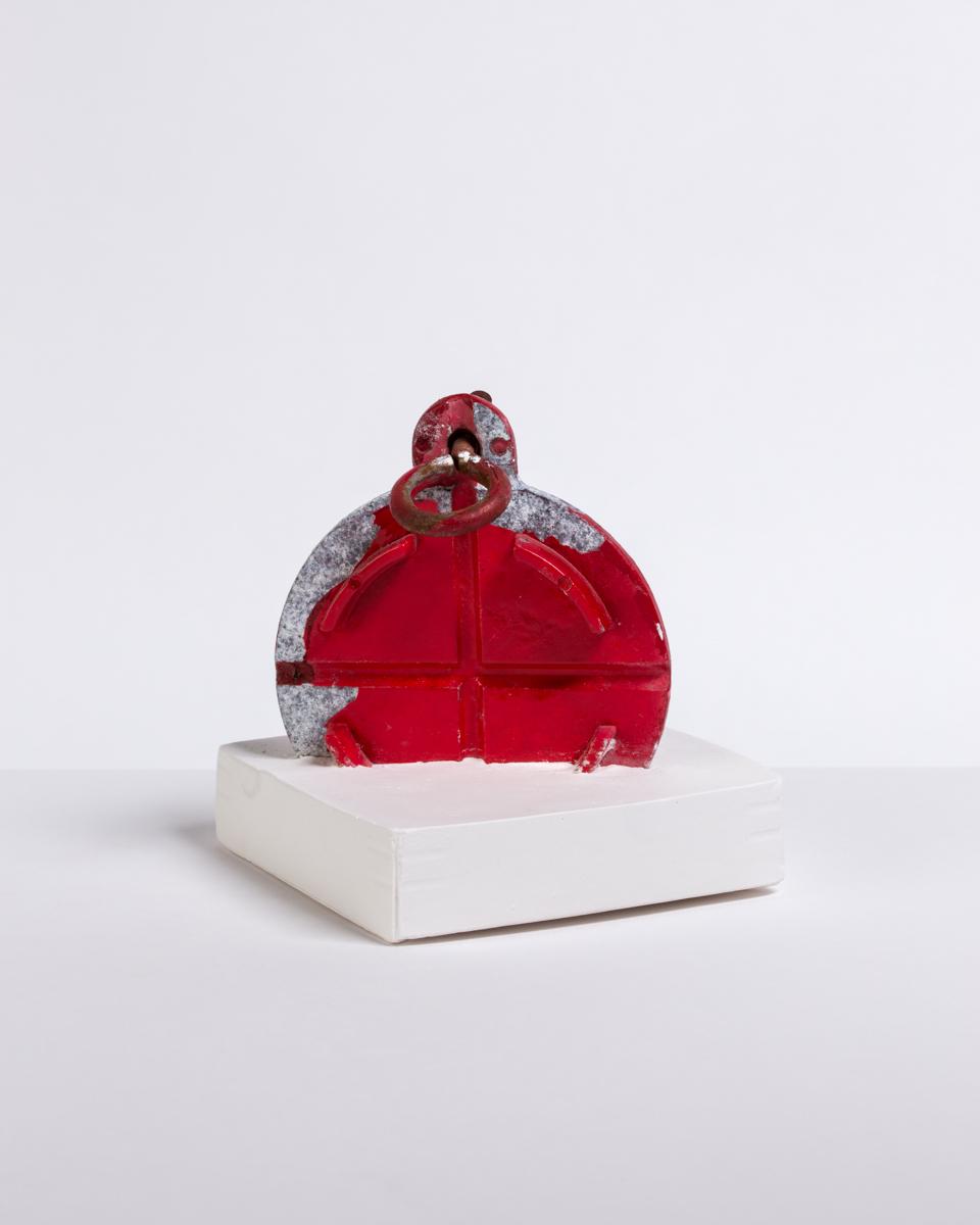 Deborah Hede,  Red Lid , 2014, metal sphere and ring, plaster, 4 ¾ × 4 × 4 in