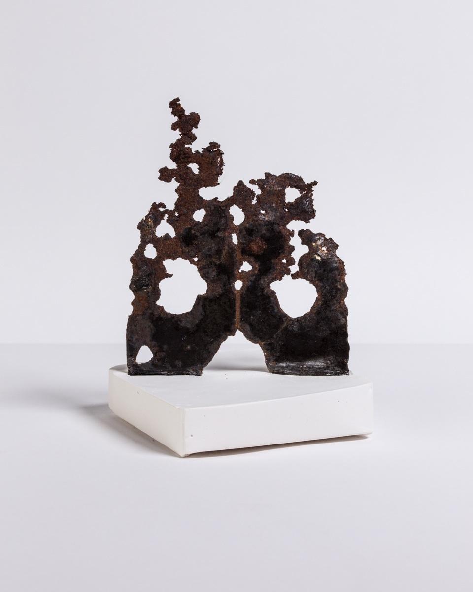 Deborah Hede,  Rusted Metal , 2014, rusted metal fragment, plaster, 7 × 4 × 4 in