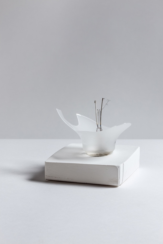 Deborah Hede,  Broken Bulb , 2013, glass, wire filament, found parts and plaster, 5 × 4 × 4 in