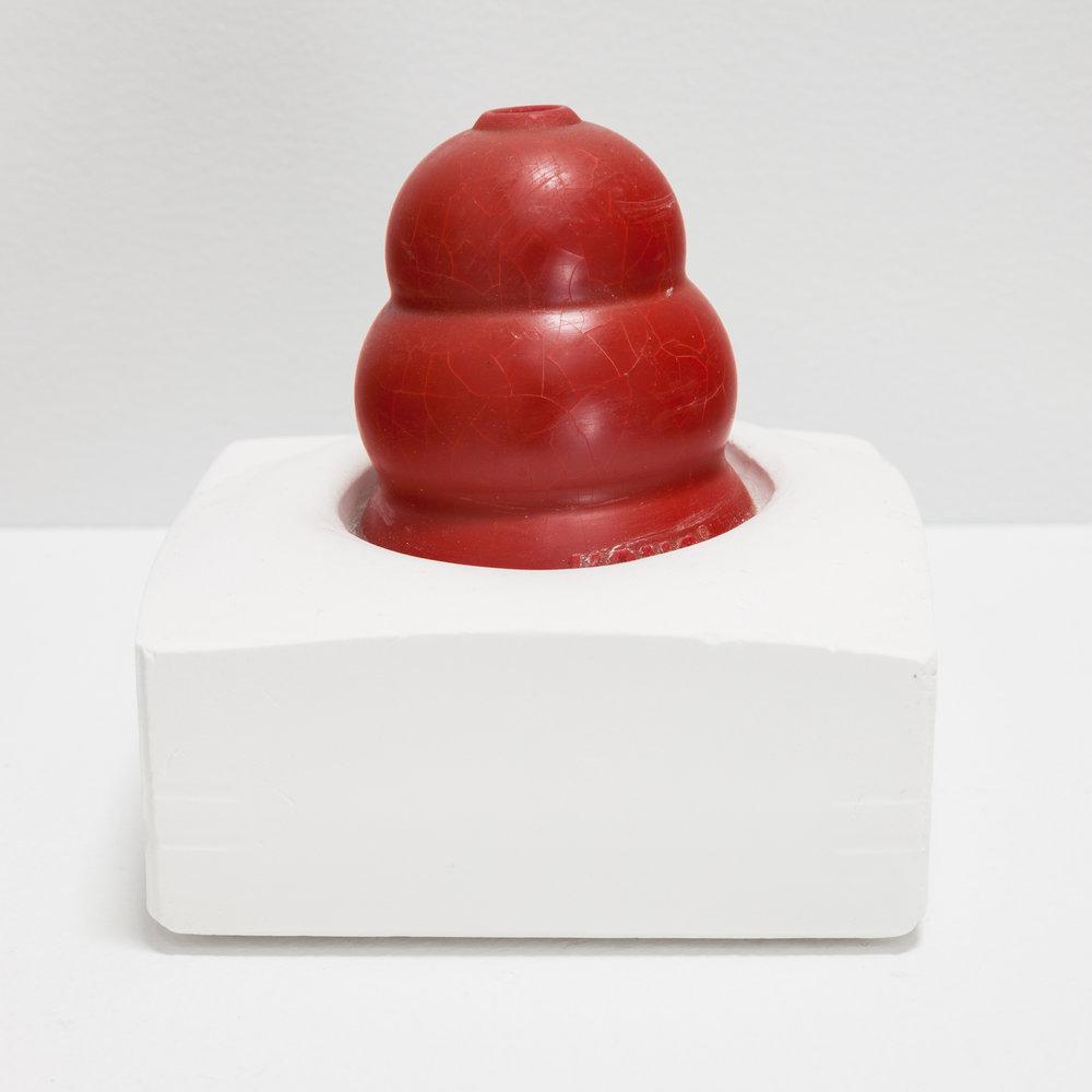 Deborah Hede,  Red Kong Ball , 2012, dog ball, plaster, 4 × 4 × 4 in