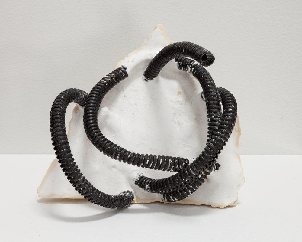 Deborah Hede,  Black Tubing , 2012, plastic tubing, plaster, 6 × 5 × 5 in