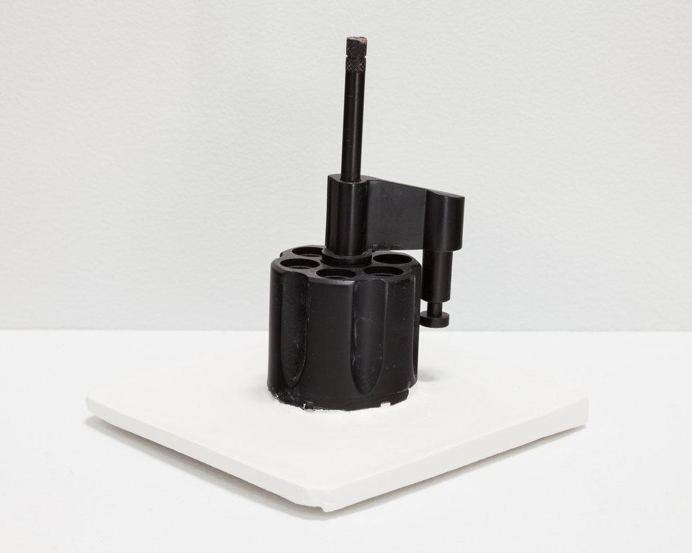 Deborah Hede,  Black Knob with turning mechanism , 2014, unidentified plastic fragment, plaster, 5 × 4 × 4 in