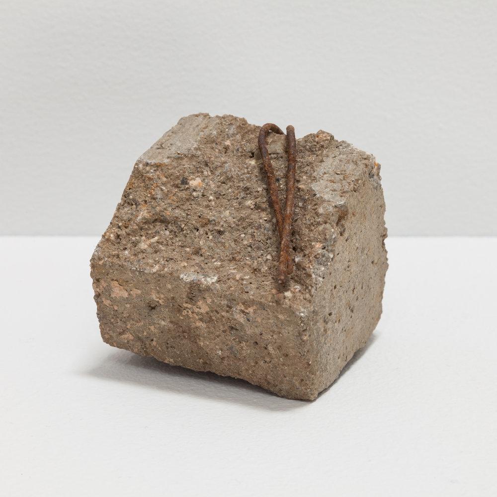Deborah Hede,  concrete amalgam fragment , 2018, found concrete and metal, 4 × 4 × 4 in