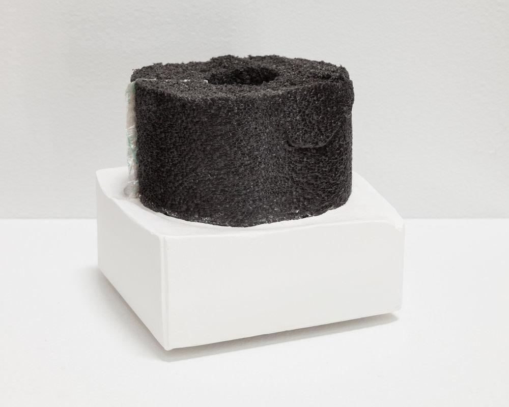 Deborah Hede,  Black Foam , 2014, black foam fragment, plaster, 3 ¾ × 4 × 4 in