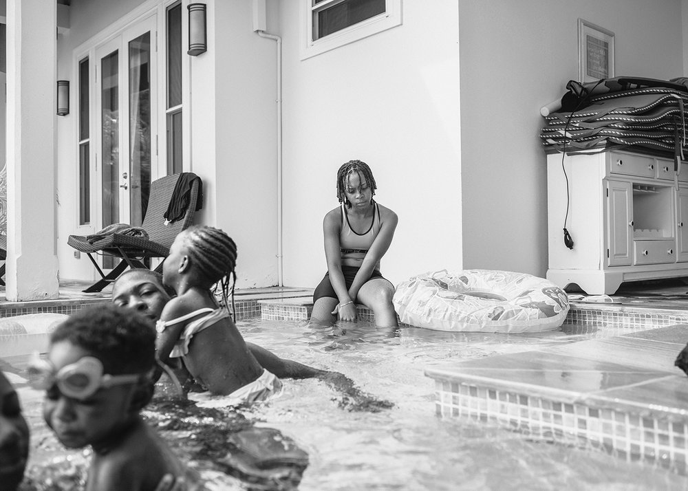 Sasha Phyars-Burgess,  Genessia and the pool, Mount Irvine, Tobago (SEA FULL) , 2018, black and white print on paper, 58 × 81 ½ in.