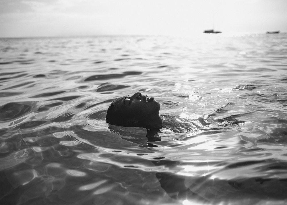 Sasha Phyars-Burgess,  Giovanni, Mount Irvine Bay, Tobago (SEA FULL),  2018, black and white print on paper, 58 × 81 ½ in.