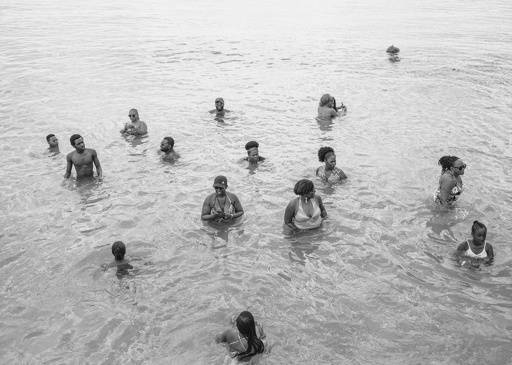 Sasha Phyars-Burgess,  Hector Family Reunion, Tobago (SEA FULL),  2018 black and white print on paper 58 × 81 ½ in.