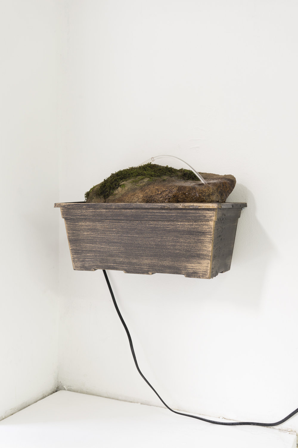 Ben Morgan-Cleveland,    Soothing Waterfall 1 , 2018, plastic basin, tubing, rocks, recirculating water pump, metal shelving brackets, water, 9 × 15 × 8 inches