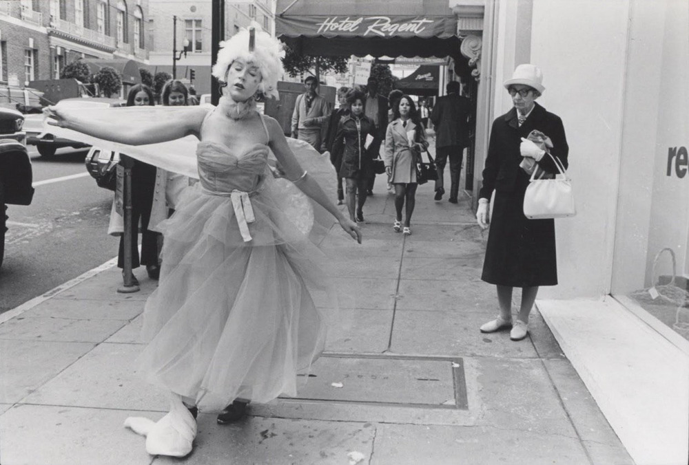 Linda Mary Montano.  Chicken Dance, The Streets of San Francisco , March 3, 6, 9, 1973 (still); performance, in front of Reese Palley Gallery, 550 Sutter Street, San Francisco. Photo: Mitchell Payne.