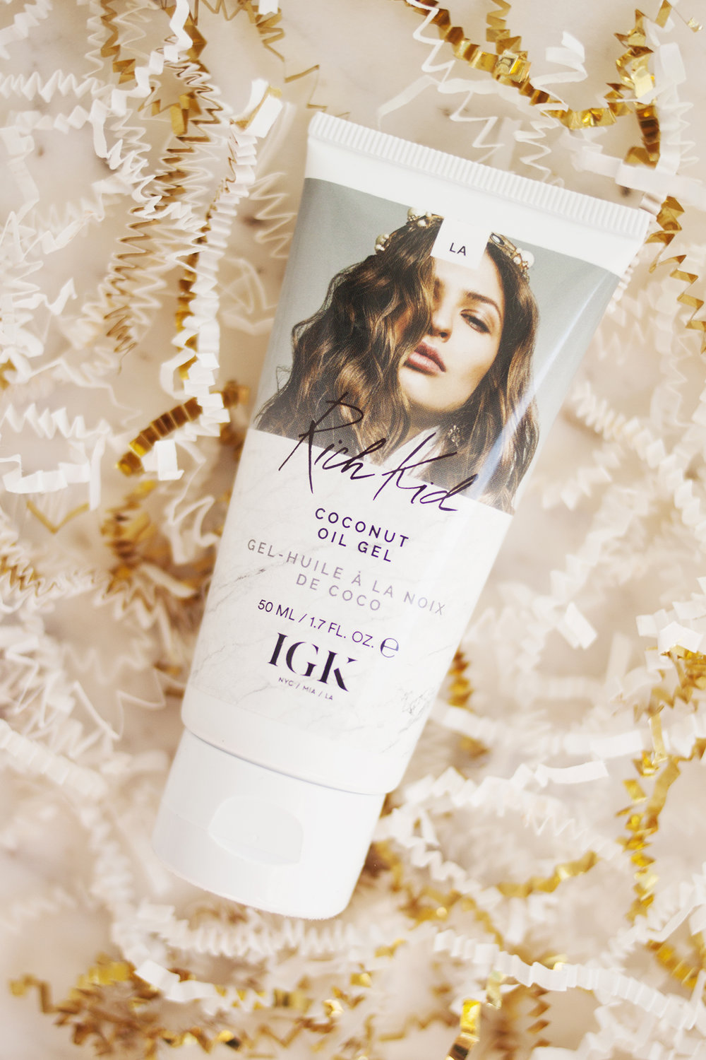 - A new hair product that I've been enjoying is the IGK Rich Kid Coconut Oil Gel. I'm not typically one to try out every new high end haircare launch, but even though IGK are fairly new on the scene, for some reason I'm really drawn to their products (good marketing & branding, I suppose). I have long, fairly straight hair but it's prone to getting really fluffy if I brush it while it's dry, so I like to apply product to wet hair after it's just been washed, let it air-dry and not do anything other than use dry shampoo until I wash it again. Anything that can tame and smooth my hair without weighing it down and that doesn't require heat styling to work is my kind of product. I still love the Living Proof Perfect Hair Day 5-in-1 Styling Treatment which I've been using for a few years now, but this is a similar kind of thing and I've been enjoying trying something new. Plus I love that IGK offer most of their products in travel sizes so you can try them out without breaking the bank, and their packaging is absolutely beautiful too.