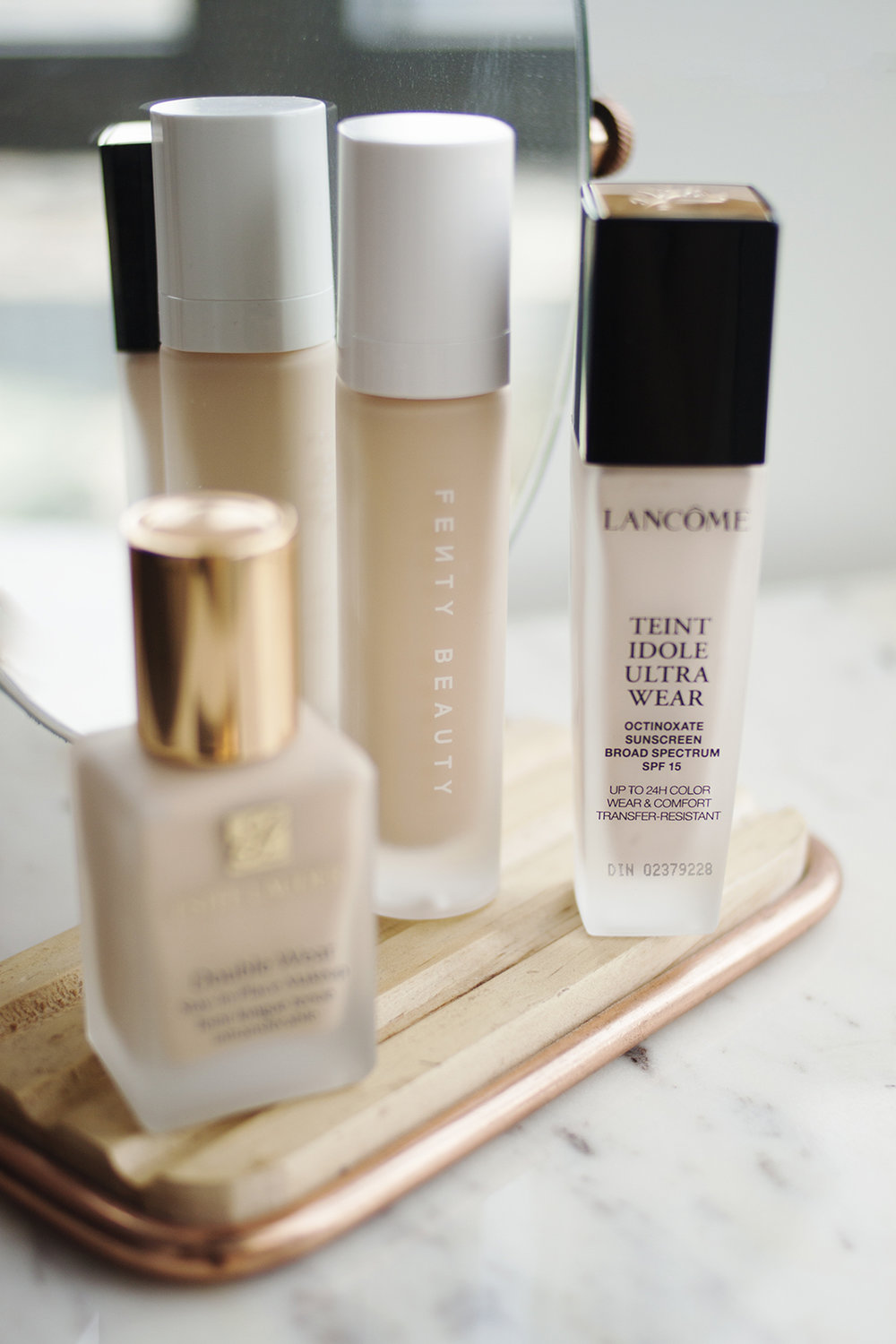 - I'm not sure how long the Lancome Tient Idole Ultra Wear Foundation (AU) has been around, but I do know that I was late to the party. I feel like this foundation really doesn't get much buzz online, but the formula is great for oily skin. It has a thin cream texture and medium coverage that I imagine could be built up if that's what you wanted to do.I find that it's barely detectable on the skin, and it lasts impressively throughout the day. Basically, it's just what I'm looking for in a foundation, and if you want a slightly more lightweight version of the original Double Wear, this is it.It also has a really impressive shade range. I'm typically the lightest shade in any foundation with a neutral/yellow undertone, and this is a bit too fair for me! I bought the shade 090 Ivoire which is the fairest neutral shade, but I probably should have gone with shade 100, which also has a neutral undertone. I can definitely make this work though, and it's really a product that deserves a lot more attention that it seems to get.