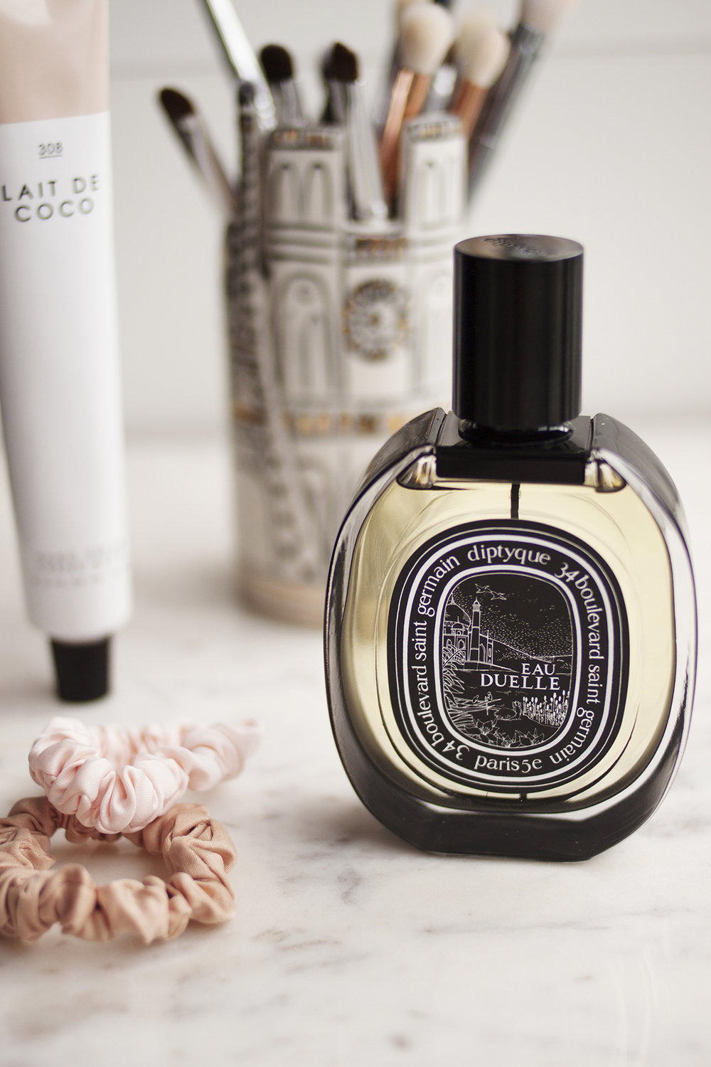 """Fragrance & Body - Maybe the most exciting thing in this entire post is Diptyque's Eau Duelle EDP (AU), which I mentioned that I fell in love with when I first smelled it a few months ago. Although I remember back in the day there was a lot of hype on the original EDT fragrance (AU), it never really did it for me. I like something very warm and heady, and I find the EDT version is still quite fresh and light, so it never really left much of an impression on me. The EDP on the other hand, is a completely different fragrance. Diptyque describe the EDT as a """"white vanilla"""" while the EDP is a """"bourbon vanilla"""" which is much more my speed. In true Diptyque fashion the packaging is absolutely beautiful, and I find the scent strong but not overpowering, and I'm so happy to finally have my own bottle.One last thing that I thought was worth mentioning is the Urban Outfitters hand cream in Lait de Coco – I mostly bought this because of the packaging, but I'm happy to say it feels like a very nourishing hand cream as well. Not one I would keep at my desk at work as it can take a bit of time to sink in, but perfect for overnight or when your hands are particularly dry (which is something I often have a problem with). It has a light milky-coconut scent (as the name would suggest) and overall I'm pretty impressed with this range from UO."""