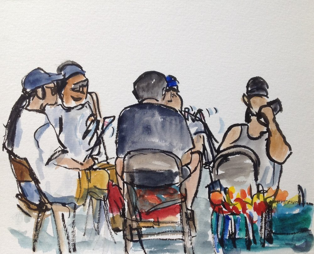 This sketch depicts one of several drum circles providing music for the dancers. Everyone is crammed so tightly together you can hardly see the drum, but their drumsticks were a constant waving rhythm. The fiery colors in the far right corner is an unused feather bustle resting in a blue wagon. One gentleman was drumming while on his cellphone! I wonder if the person on the other line could hear him at all?