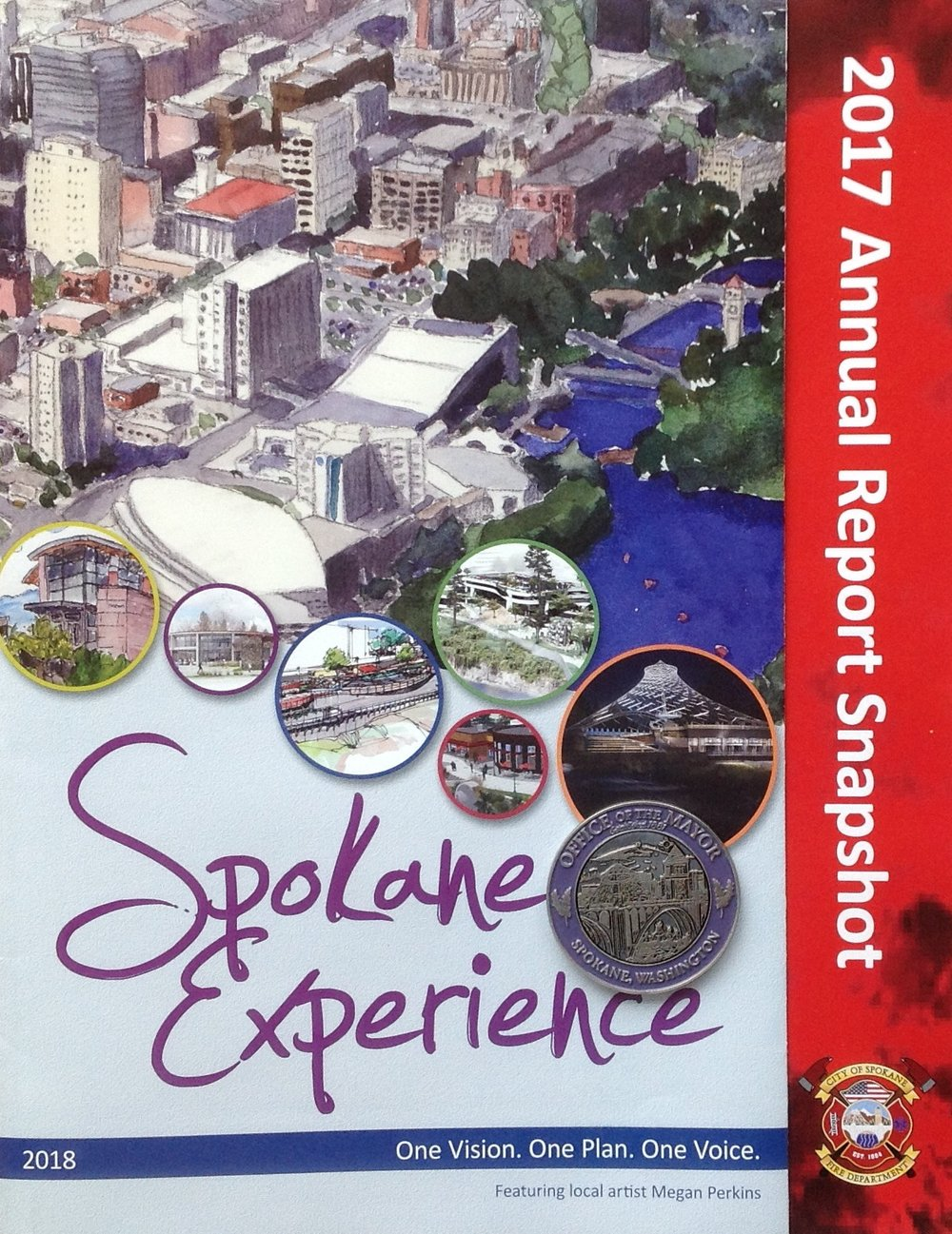 Here's the report for the city that was handed out to all the attendees. Photographed just below the circle with the Pavilion in it, is the Coin of the City, which was presented to me at the end of the speech. I suppose it is like the traditional Key of the City.   Here's to Spokane and its future!