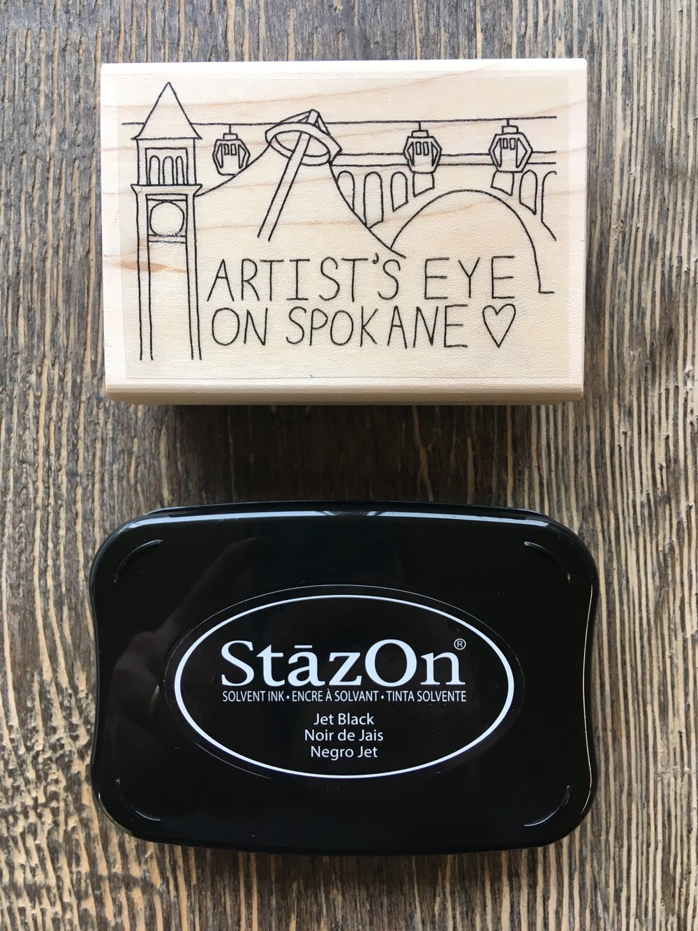 A custom Artist's Eye on Spokane stamp! We blew past that stretch goal ($5,500) in one day, so now everyone who buys a book through the Kickstarter will receive a stamp on the inside of their book!