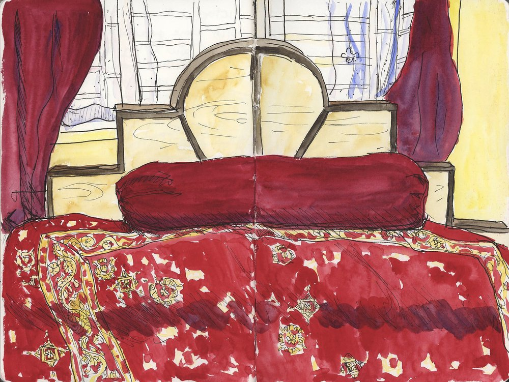 The bed in our room was very comfortable in red and gold. Every night we erected a tent of mosquito netting to protect us and slept under it with the fan on.