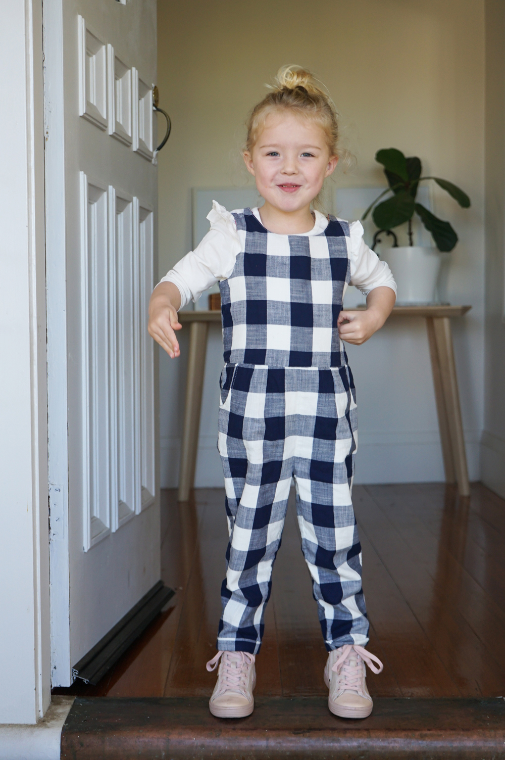 Mabel wears  Marks & Spencer   Checked Jumpsuit  +  Frill Cotton Top .