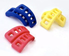 Genki-kun toe stretcher has red, blue and yellow color