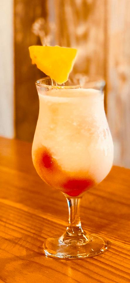 LA PINAOn ice, fill glass with 1.5 oz of Wild Rag Vodka or Wild Rag Mesquite Bean Vodka, ½ cup Pina Colada Mix, 2 oz Pineapple Juice and pour in a blender. Blend to desired consistency. Garnish with pineapple. -