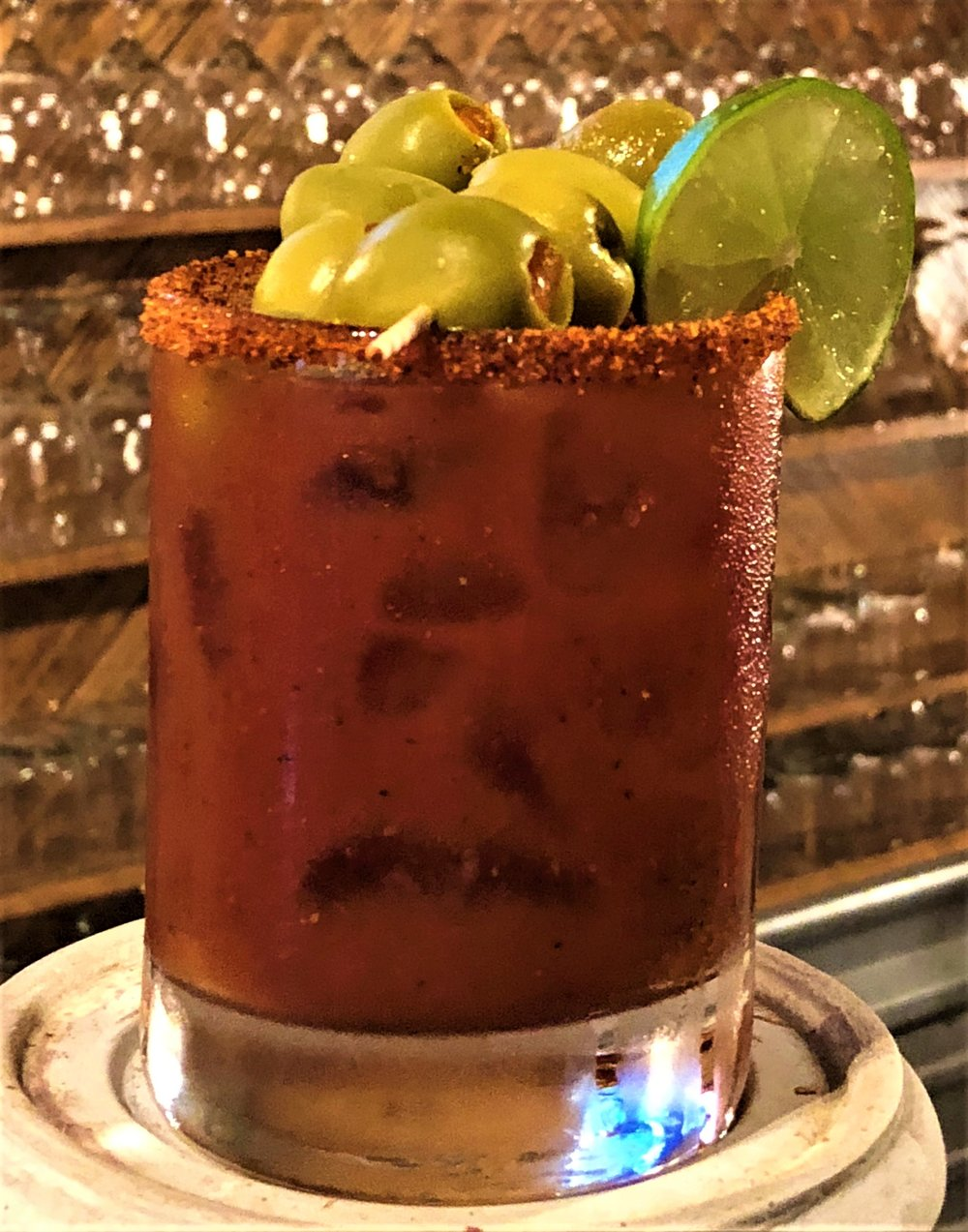 The Wild Armadillo Bloody Mary  - In a shaker, add 1 or 2 shots WILD RAG VODKA or WILD RAG MESQUITE BEAN VODKA, 3/4 Zing Zang Bloody Mary Mix, squeeze of lime, dash of Tabasco, Worcesterhire sauce, celery salt, pepper, & shake. Rim glass with Spicy Salted Trechas. Pour ingredients over ice. Garnish with olives.